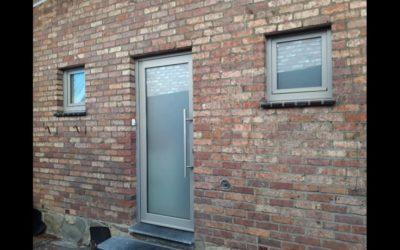 Pose de porte de garage et châssis à Liège (Romsée) RAL 7030
